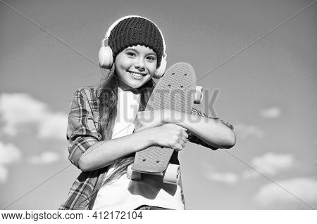 Just A Little More Plastic Underfoot. Happy Skater On Blue Sky. Small Kid Hold Penny Board. Riding P