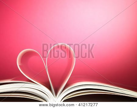 pages of a book curved into a heart shape