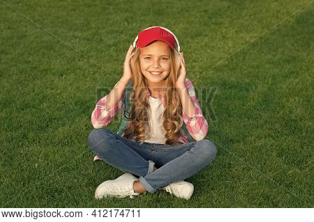 Soothing Audio Sounds. Happy Baby Listen To Music Outdoors. Little Child Wear Audio Headphones. List