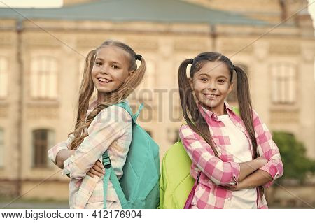 Vacation Is Over. Back To School. Cute Schoolgirls With Long Ponytails. Ending Of School Year. Cheer