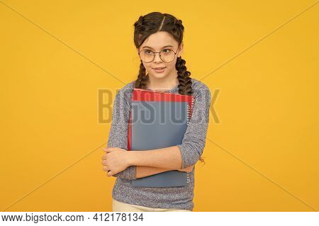 Achieve Your Study Goals. Small Girl Hold Books Yellow Background. Little Child Back To School. Stud