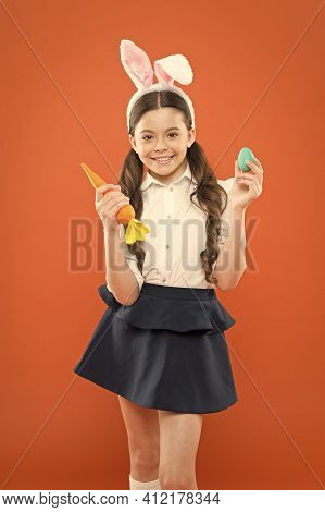 Which One Do You Want. Child Bunny Costume With Carrot. Little Happy Girl Hold Painted Eggs. Egg Hun