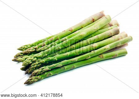 Bunch Of Asparagus Isolated On White. High Quality Photo