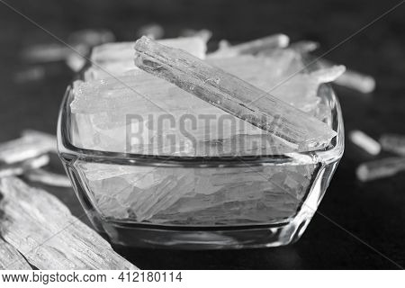 Menthol Crystals In Bowl On Grey Background, Closeup