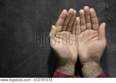 Man Showing Pale Palms At Grey Table, Top View With Space For Text. Anemia Symptom