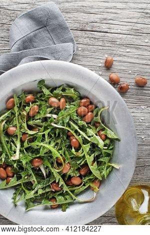 Fresh Dandelion Salad With Beans On Wooden Background