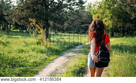 Local Travel, Rural Tourism, Staycations, Gen Z Traveler, Young Adventurer, Solo Travel. Back View O