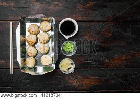 Take Away Sushi Rolls In Containers, Philadelphia Rolls And Baked Prawn Rolls Set, On Old Dark  Wood