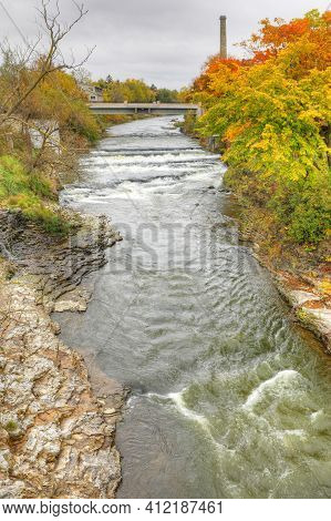 A Vertical Of The Grand River At Fergus, Ontario, Canada In Autumn