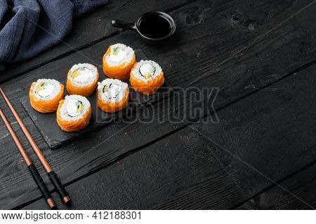 Uramaki. Philadelphia Classic. Salmon, Philadelphia Cheese, Cucumber Set, On Black Wooden Table Back