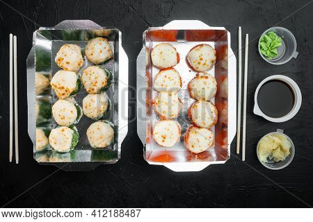 Take Away Sushi Rolls In Containers, Philadelphia Rolls And Baked Prawn Rolls Set, On Black Stone Ba