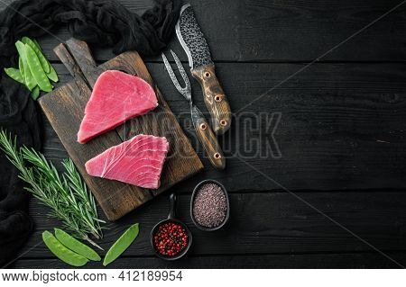 Raw Tuna Fillet. Seafood With Sugar Green Pea, Sesame And Ingredients Set, On Wooden Cutting Board,
