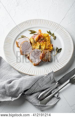 Grilled Pork Fillet And Mash Potatoe Gratin With Sage And Prosciutto Set, On Plate Dish, On White St