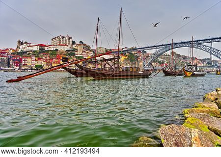 Portugal Traveling Concepts. Cityscape Of Porto City In Portugal With Traditional Attraction Boat In
