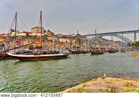Portugal Destinations. Cityscape Of Porto City In Portugal With Traditional Attraction Winery Boats