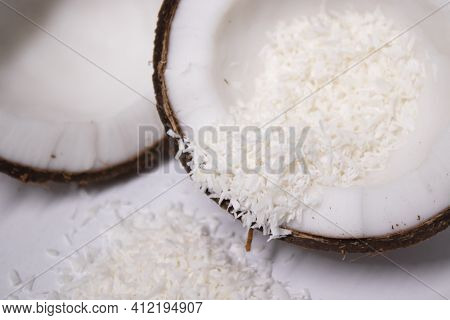 Opened Coconut With Coconut Flakes Isolated On White Background. Tropical, Nut