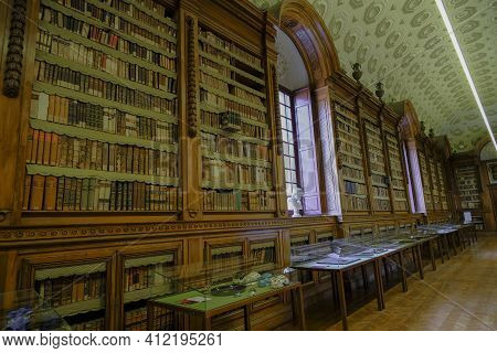 February 2021 Parma, Italy: Interior, Stairs, Shelves Full Of Ancient Books Of The Biblioteca Palant