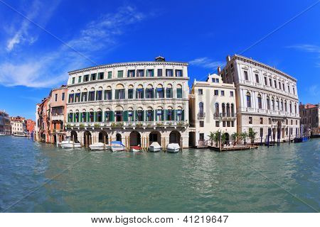 Great Venetian palazzo, surrounded by mirrored waters of the channel. Photo making the lens Fisheye