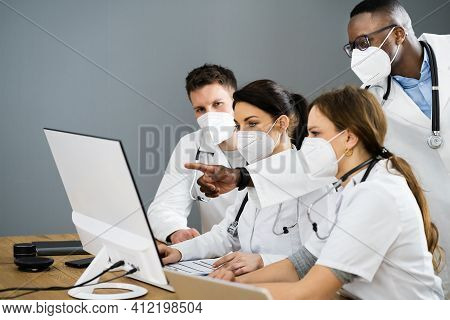 Physician Medical Doctor Training Diverse Group In Face Mask