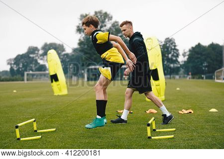 Young Soccer Athlete Practicing Strength And Agility Skills At Soccer School Academy. Soccer Coach C