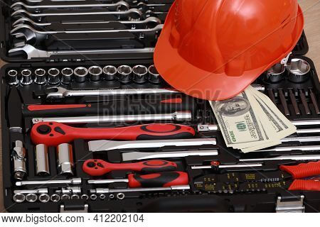 Toolbox, Tools Kit Detail, Dollar Bills And Orange Protective Helmet Close Up. Instruments. Set Of T