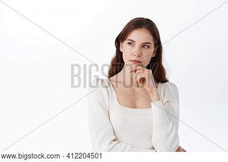 Portrait Of Pensive Brunette Dreamy Hipster Girl Imagines Something In Her Mind, Looks Upwards, Bein