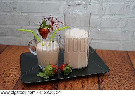 Strawberry Meets Caramel Almond Milkshake. Almond Milkshake Served In A Glass.