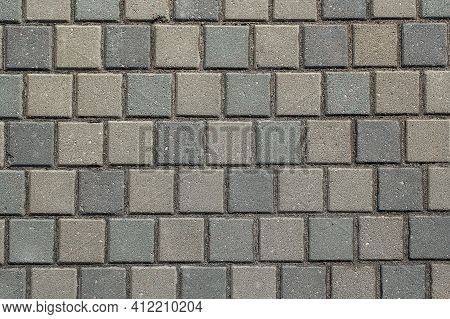 The Texture Of Concrete Tiles. Background Of The Sidewalk Of The City. The Texture Of The Sidewalk O