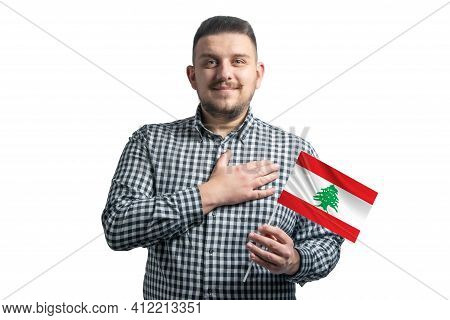 White Guy Holding A Flag Of Lebanon And Holds His Hand On His Heart Isolated On A White Background W