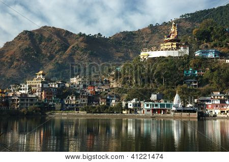 Sacred Rewalsar Lake With Big Golden Statue Of Padmasambhava At The Top Of The Buddhist Monastery