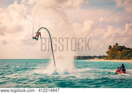 August.21.2019, Noonu Atoll, Maldives Islands: Professional Pro Fly Board Rider In Tropical Sunset S