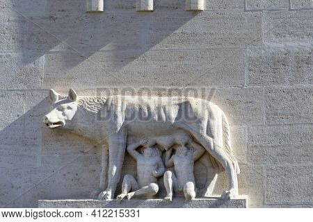 Relief Of She-wolf Suckling The Mythical Twin Founders Of Rome, Romulus And Remus On Facade Of Build