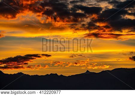 Sunset Over The Mountains. Dramatic Sky At Sunset With Red, Yellow And Orange Colors. Lausanne, Swit