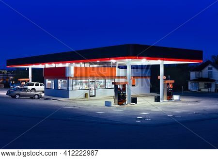 Horizontal Shot Of A Generic Gasoline Station And Convenience Store At Dusk.