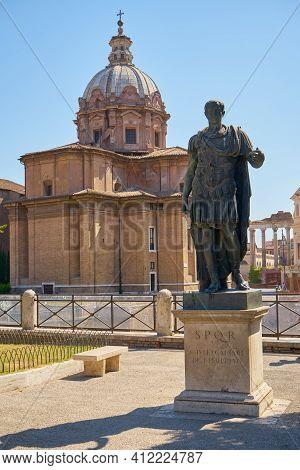 Statue Of Caesar In Sunny Rome In Summer.