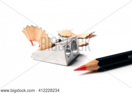 red pencil, sharpener and shavings