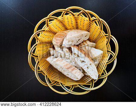 Bread  basket - little roll breads in a basket on the table
