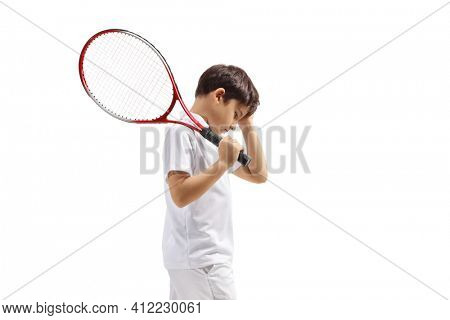 Disappointed boy with a tennis racquet isolated on white background