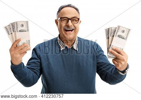 Excited and cheerful mature man holding us dollars and smiling isolated on white background