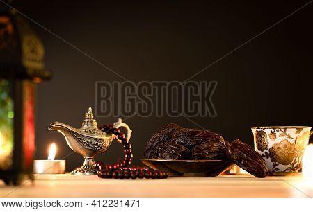 Ramadan Food And Drinks Concept. Ramadan Lantern With Arabian Lamp, Wood Rosary, Tea, Dates Fruit An