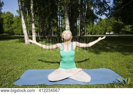 Blonde Real Girl Doing Yoga In Green Park, Lifestyle Sport People Concept