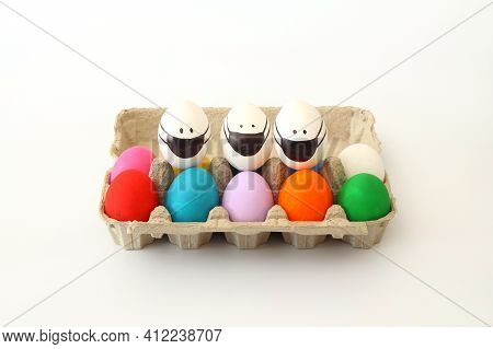 Colorful Easter Eggs In Egg Carton On The Table With Copy Space For Text. Easter Eggs With Corona Vi