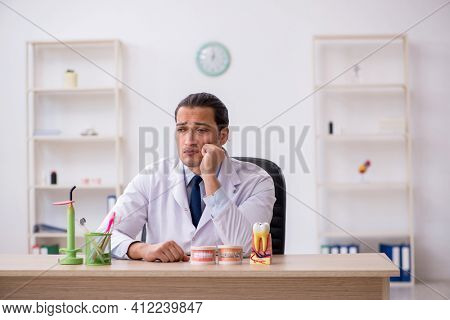 Young male doctor stomatologist working in the clinic