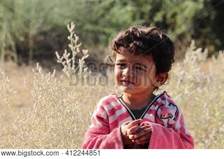 A Small Boy Of Indian Origin Looking At The Camera With Small Eyes.concept For Today's Children Tomo