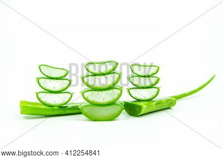 Slices Of Fresh Aloe Vera Plant Stacked And Aloe Vera Stalk Or Leaves With Water Dropping Isolate On