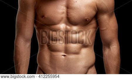 Closeup Image Of A Strong Athletic Man Showing Muscular Body And Sixpack Abs Isolated Black Backgrou