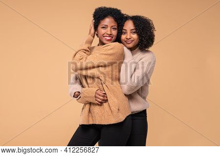 Young Women Posing Together , Smiling And Looking At Camera. Beauty Portrait Of Two Afro Female Mode