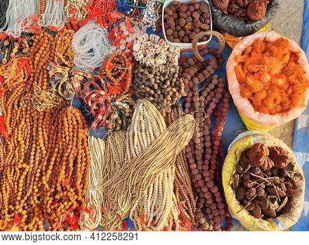 High Angle Shot Of Hinduism Prayer Rosary Beads Mala And Other Spiritual Things For Sale In Outdoor.