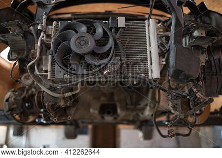 Disassembled Machine Front, Car Radiator And Fan. Car Engine Removing. Detail Of A Car Engine Room W