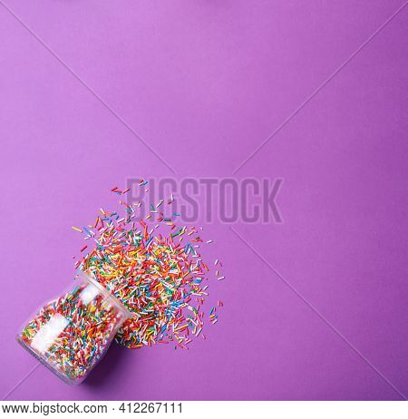 Jar With Colorful Sprinkles And Space For Text On Purple Background, Flat Lay. Confectionery Decor